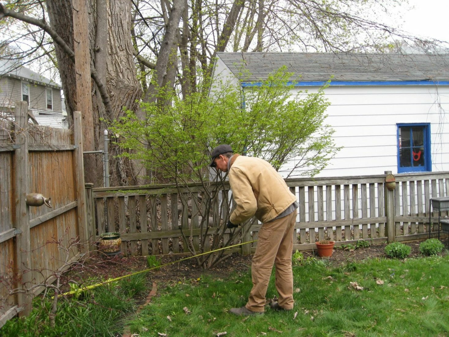 Landscape designer measuring yard albany ny